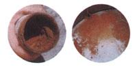 不純物が付着した水道管の断面